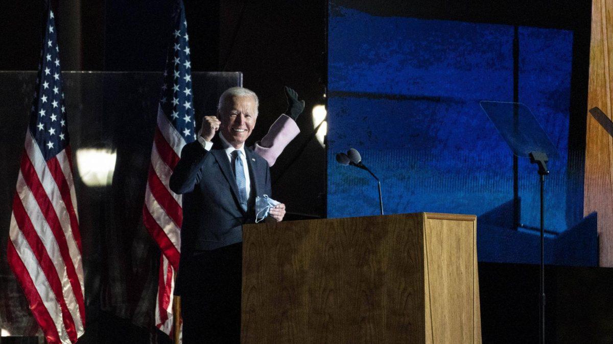 Joe Biden, 2020 Democratic presidential nominee, gestures towards supporters during an election night party in Wilmingt