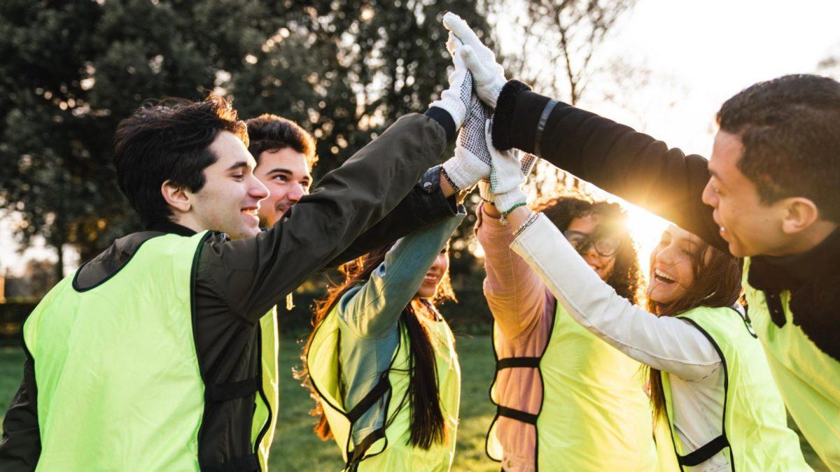 Junge Menschen Teamwork High Five