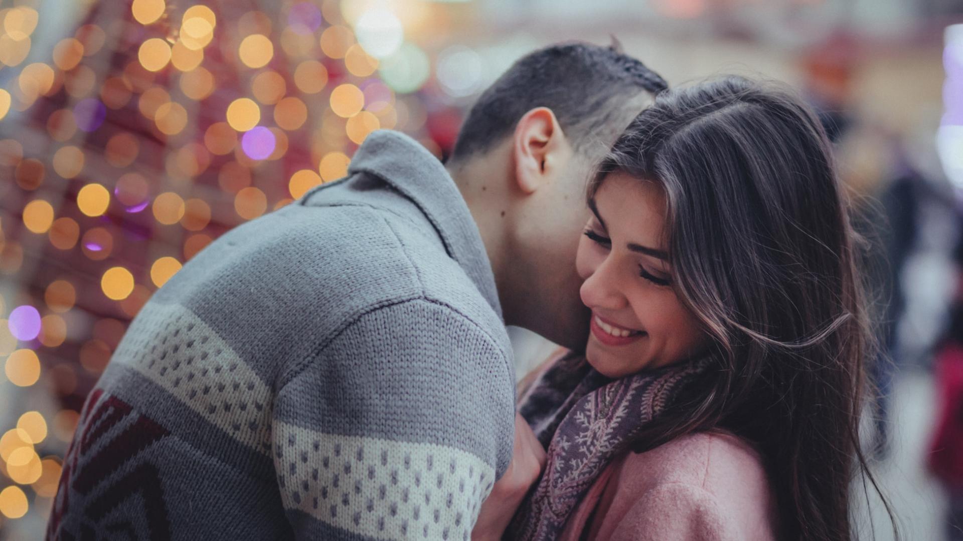 Couple kissing Christmas