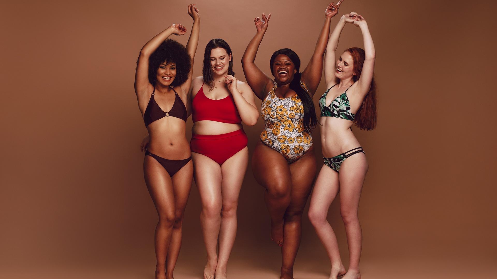 Fröhliche Frauen jeglicher Körperform