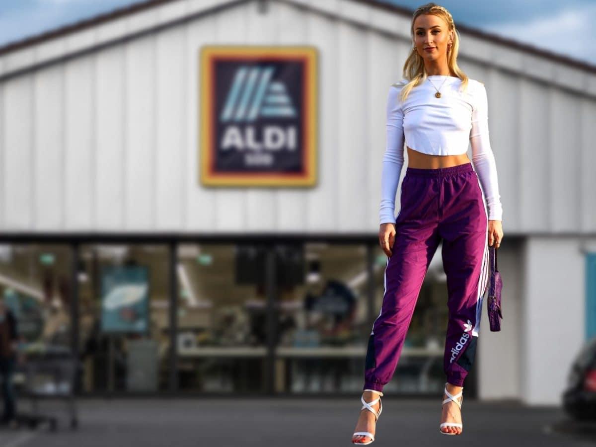 Aldi Frau vor Supermarkt
