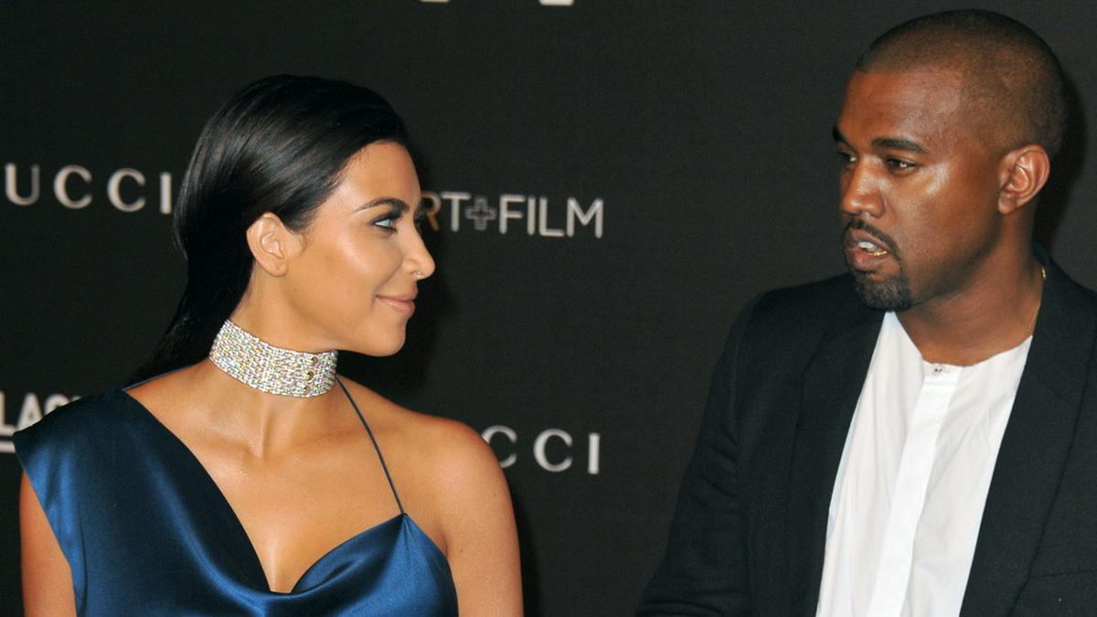 Kim Kardashian und Kanye West 2014 auf dem roten Teppich. © Featureflash Photo Agency / Shutterstock.com