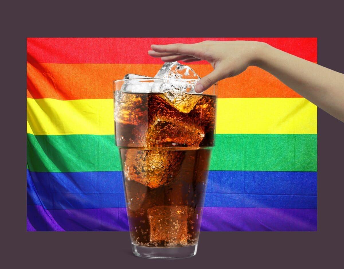 Hand mit Cola und Pride Flag