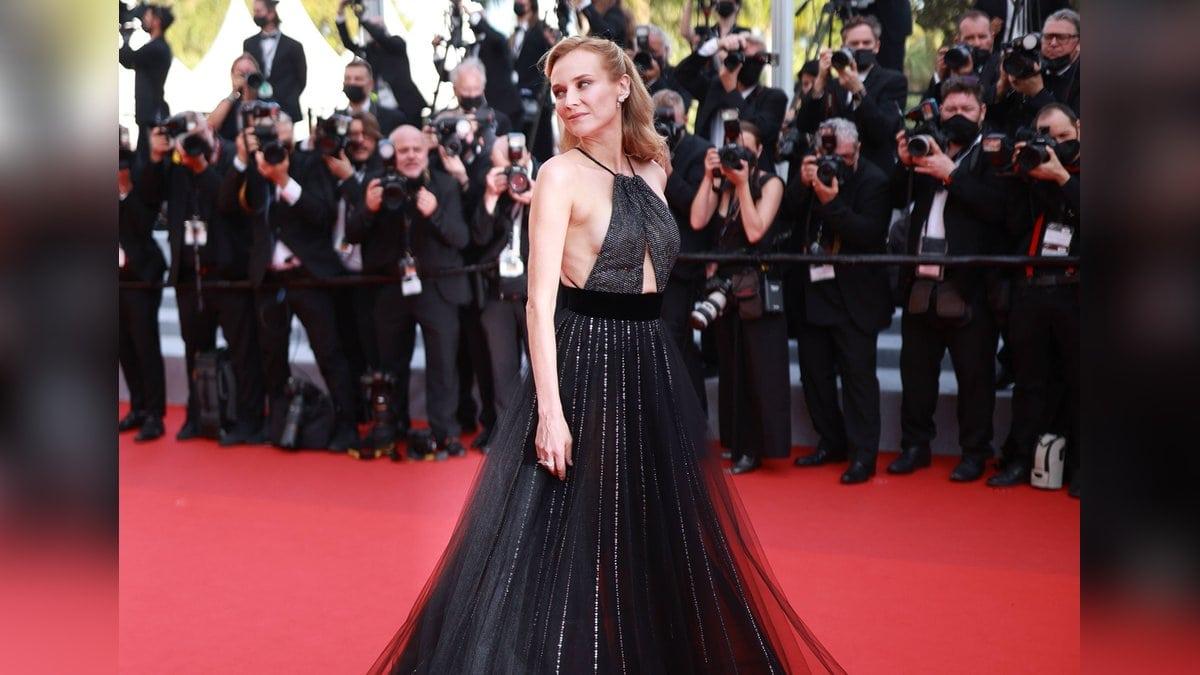 Diane Kruger meistert das Blitzlichtgewitter in Cannes. © imago/Starface