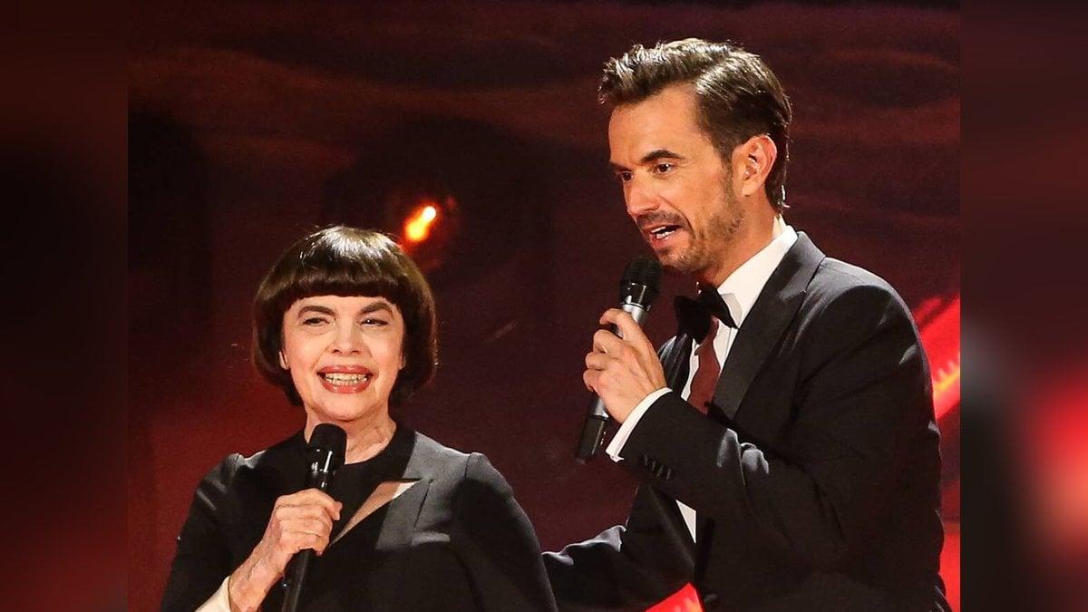 Mireille Mathieu und Florian Silbereisen 2018 bei einer Liveshow der ARD. © imago images/Christian Schroedter