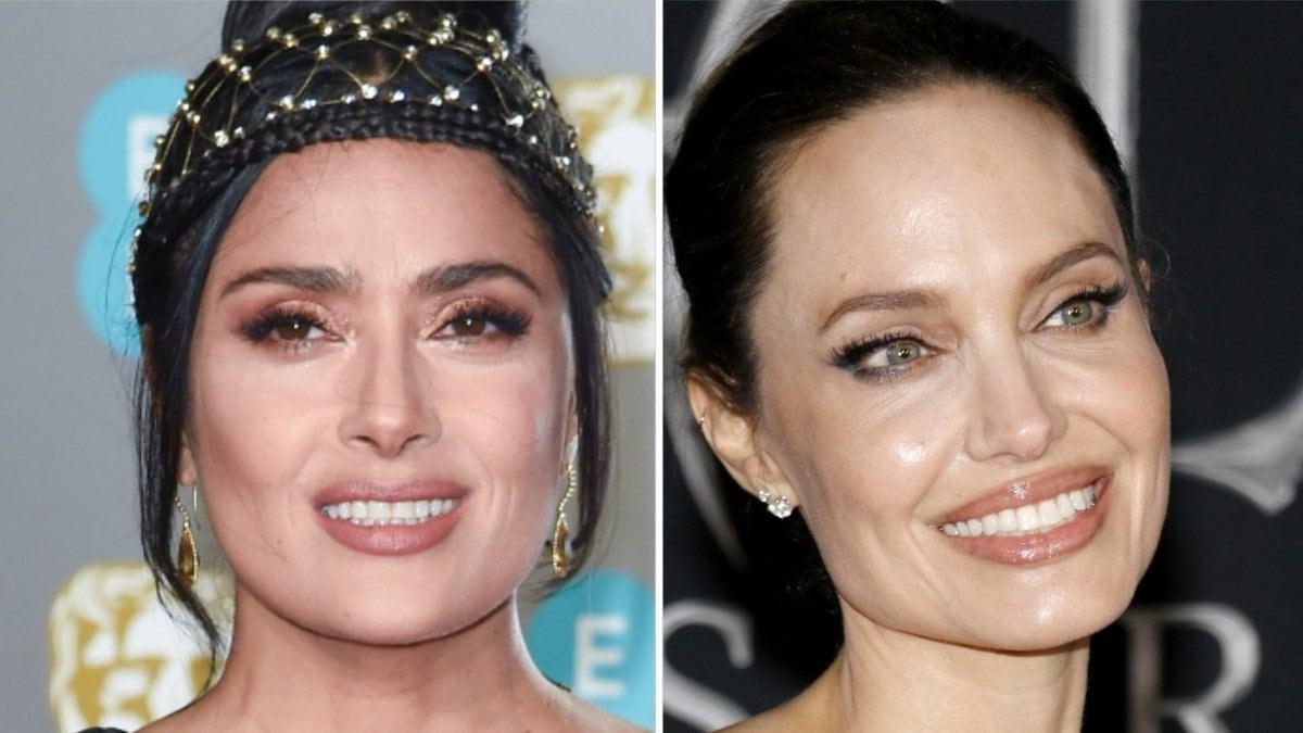 Salma Hayek (li.) versteht sich blendend mit Angelina Jolie.. © Featureflash Photo Agency/Shutterstock.com / Tinseltown/Shutterstock.com
